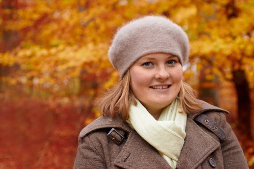 Fall - Cute young woman looking at you with copyspace