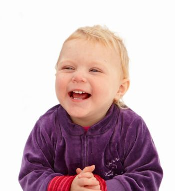 Cute baby girl smiling on white background