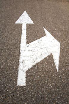 arrows on asphalt
