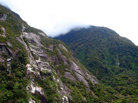 Cliff faces of the mountains containing Milford Sound, New Zeala