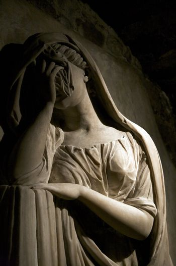 sculpture of woman crying