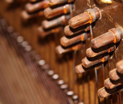 Inside of an Upright Piano - tuning knobs and strings