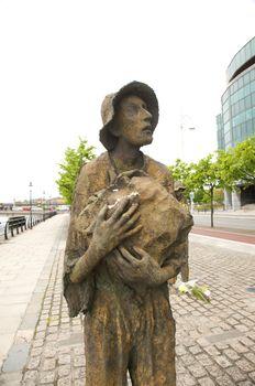 sculpture of starving man