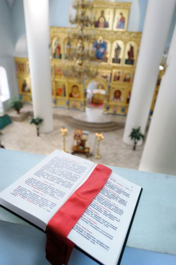 Orthodox Holy Bible on the table agains the sanctuary