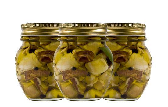 Three jars of mushrooms in oil