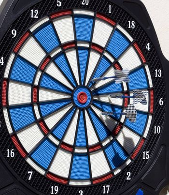 darts game hitting bullseye as an success and business iconic image