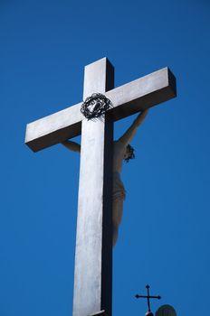 brilliant cross with christ sculpture