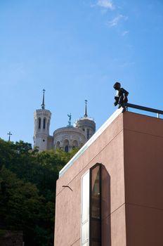 sculpture and far church
