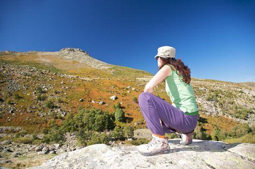 squatting watching peak