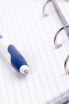 organizer, notebook and pen