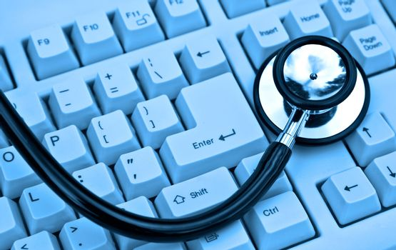 stethoscope on a keyboard in cool blue