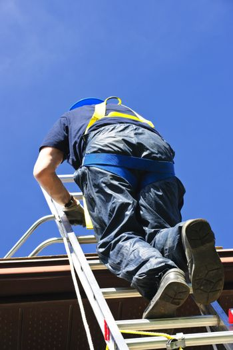 Construction worker climbing ladder