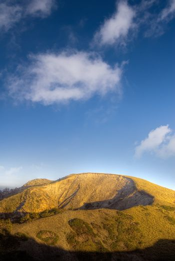 Dramatic landscape of golden mountain with blue sky.
