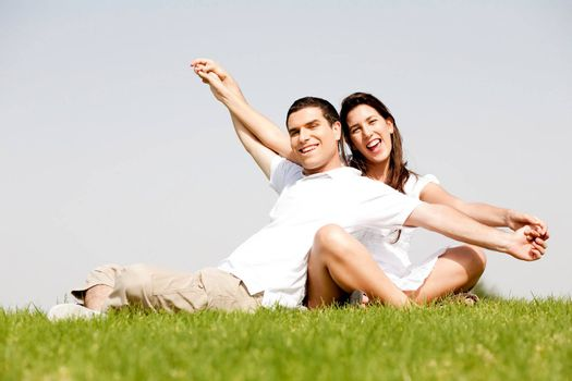 Cute young couple in a hands outstretched