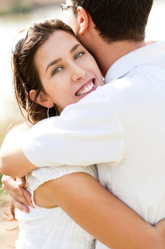 Closeup Portrait Of A Cute Couple Hugging , Focus On Female