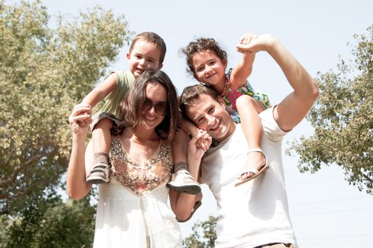 Parents with children sitting on the shoulders