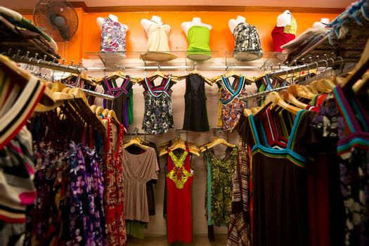 Clothes on the racks in female shop