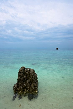 Single boat in endless blue sea