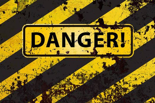 """""""Danger"""" on the grunge yellow-black striped  background"""