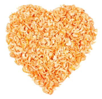 Heart made of dried shrimps, isolated on a white background
