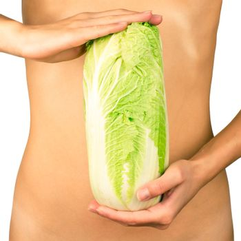 Cabbage in the hands on the background of slim female body