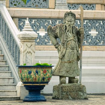 Sculpture of mythological guardian in Grand Palace, Bangkok, Thailand