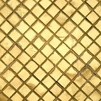 The wall with golden mosaic in Grand palace, Bangkok, Thailand