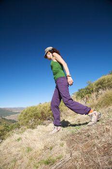 female walking on slope