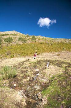 hiking over stream