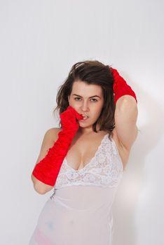 sexy girl posing in red satin gloves