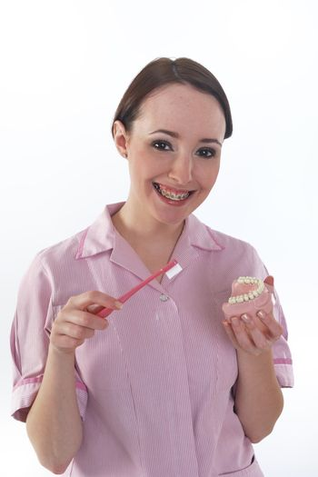Dental hygenist with dentures and brush