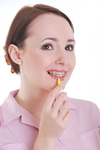 Dental hygenist cleaning teeth with braces