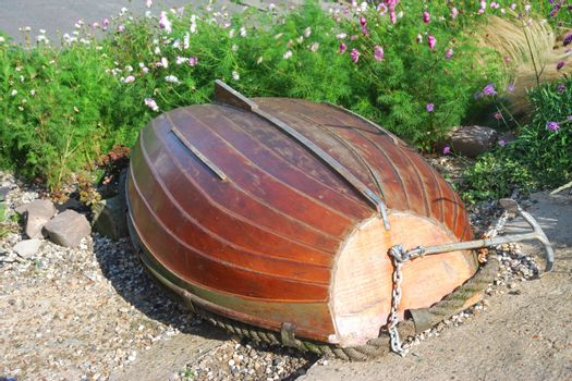 overturned rowing boat among flowers