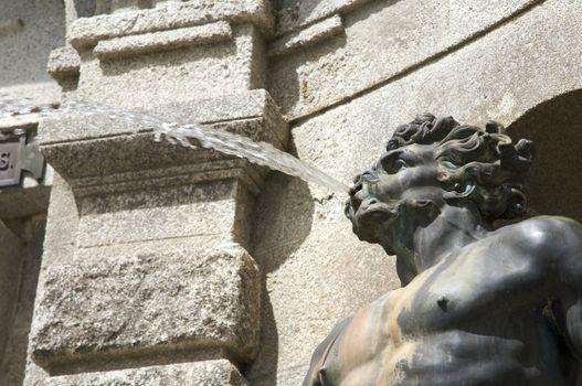 spitting man sculpture