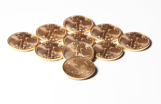 Diamond shaped gold coins on white