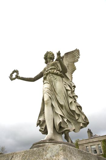 winged woman sculpture