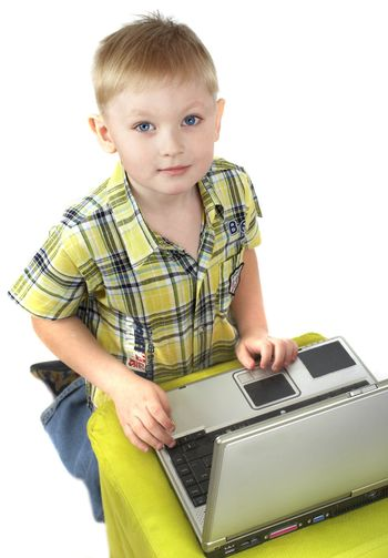 The boy the blonde is engaged with a computer