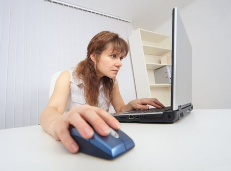 Young woman with concentration works in Internet