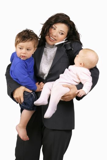 A career woman busy with toddler, baby and telephone