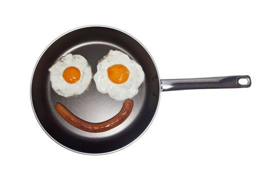 Saucepan with eggs and a sausage