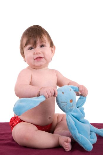 Happy little baby with her play bunny on white backgroun