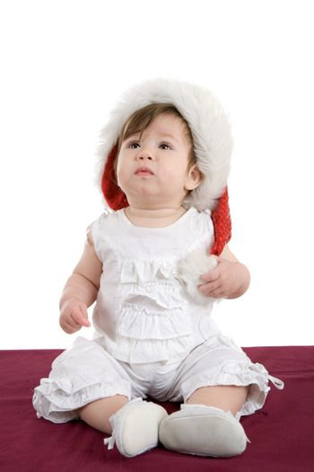Cute little baby girl sitting on white background
