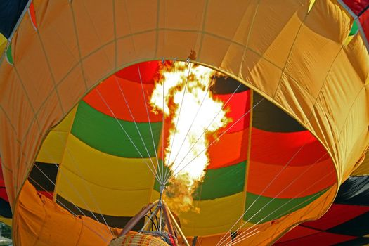 Hot flames from a burner used to heat up the air in a balloon