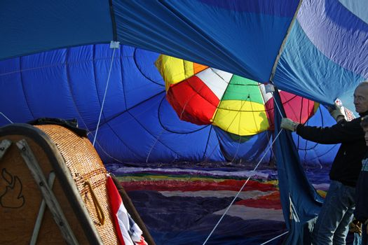 View inside a balloon being filled with hot air
