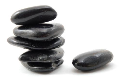 black stones in balance isolated on white background