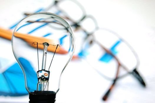 bulb with business background showing concept of success an idea