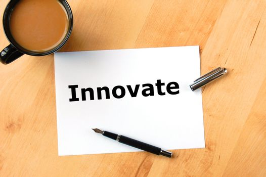 innovate or innovation business concept with coffee pen and paper in office
