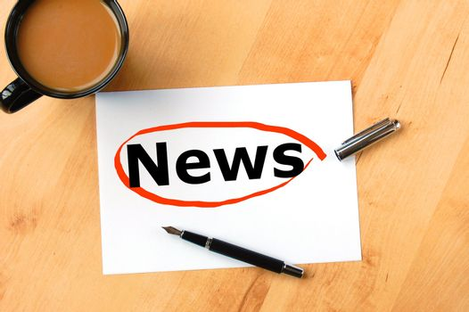 latest news concept with pen paper and coffee in business office