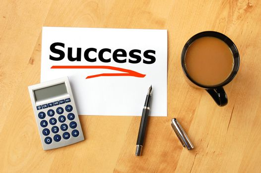 business success concept with pen paper and coffee in office