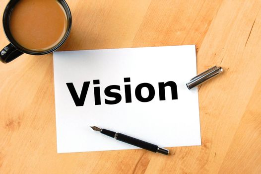 business vision concept with paper pen and coffee in office